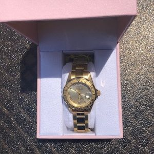 Invicta ladies angel watch in gold. Accent crystal